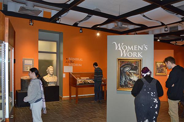 Students visit the Women's Work exhibit in the Earth and Mineral Sciences Museum & Art Gallery.