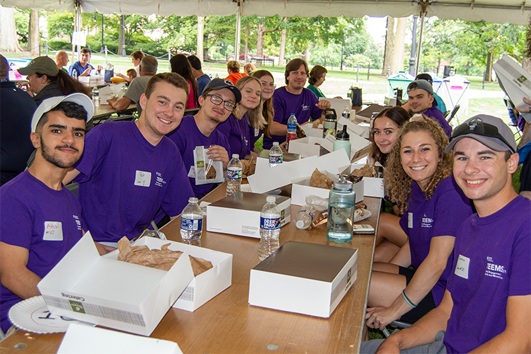 an image of students enjoying lunch at a TEEMS event